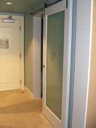 barn door frosted glass master bath