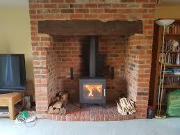 westfire uniq 23 in an inglenook fireplace in a barn conversion in long crendon bucks