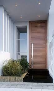 Um dos tipos de portas de entrada mais modernas que existem são as pivotante. Porta Pivotante Modelo Exclusivo Ecoville Portas Especiais Exteriores De Casas Fachadas De Casas Terreas Porta Pivotante