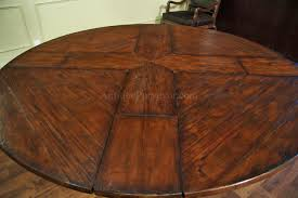 walnut circular expandable pedestal table with popup leaves