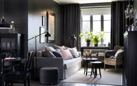Small open plan dark grey living room and dining area and a medium grey  sofa.