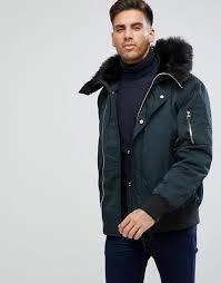 river island er jacket with faux fur hood in black men
