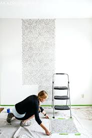 accent wall stencils tip wipe your wall stencil on your drop cloth in between placements to avoid smearing diy accent wall ideas stencil