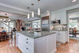 contemporary kitchen with white cabinets gray granite and gray tile backsplash