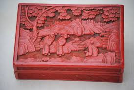 red carved wooden box with patterns of characters china early 20th century