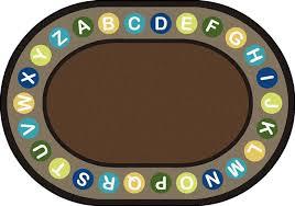 alphabet spots circletime rug earthtone