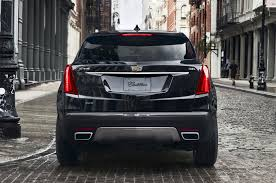 2018 cadillac black. fine 2018 2018 cadillac xt5 black color back side city background hd wallpaper on cadillac