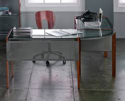 glass surfaces add a boldly modern touch to any desk paired with wood or metal
