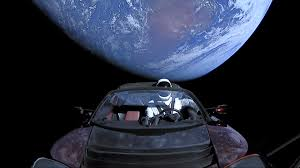 tesla roadster into e with e suit man