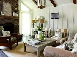 white foyer table. Antique Distressed Wood Coffee Table With Dark Brown Armchair On Sisal Rugs And White Foyer Lamp Plus Stone Fireplace Design