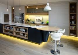 led kitchen cabinet lighting featuring dark brown varnished wooden cabinet simple white island bar side modern white ceramic bathtub black plain painted