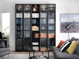 ikea black brown bookcase natural wood veneer surface shallow shelves to use small wall spaces effectively adjule hinges door tempered glass door