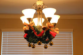 formal dining lighting decoration garland from dollar tree ribbon from hobby lobby and dollar tree ornaments from bed bath beyond