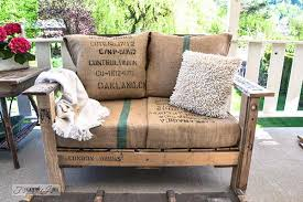 outdoor furniture from pallets. they obviously create it out of pallets but was taken one step further made cushions from old burlap bags along with really cute pillows too outdoor furniture