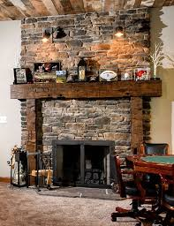 Now, this fireplace has a classic rustic aesthetic. The hefty looking stone  facade finds its perfect complement with a solid, substantial timber framed  ...