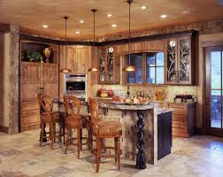 stylish triple brushed bronze pendant lights over island with wooden backchairs stools as well as unfinished cabinetry sets in rustic kitchen ideas