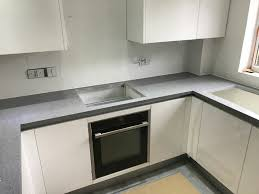 stunning grigio scuro stella dark grey starlight quartz worktops with white high gloss kitchen with white starlight quartz tiles