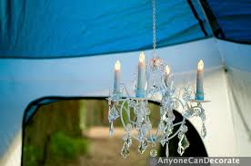 the chandelier is lightweight weighing less than three pounds and i used battery operated candle lights in it for safety the battery operated lights even