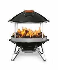 small and functional outdoor wood burning fireplace from weber with round design and four legs