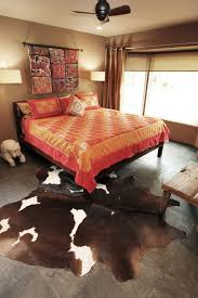 stunning cowhide rug decorating ideas for bedroom eclectic design ideas with stunning animal hide rug
