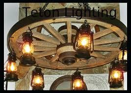 wagon wheel chandelier the wild west large wagon wheel chandelier wide by small wagon wheel chandelier downlights