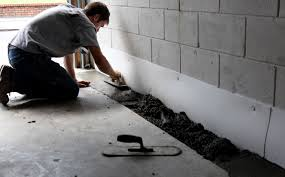 united structural systems inc is shown waterproofing the interior of a home by covering