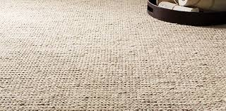 above a rug from the textura plaited wool collection by ben soleimani for restoration hardware