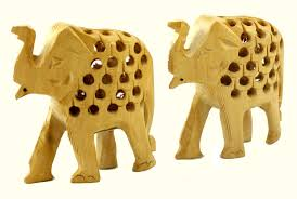 a pair of hand carved elephant wooden jali figurin
