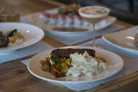 the pan seared top sirloin foreground is served with the rio de janeiro