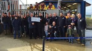hunstanton and district round table presented a cheque for 2000 to hunstanton rnli