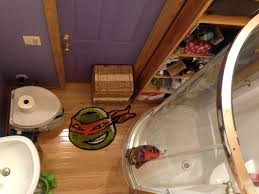 tiny house bathroom with shower sink and toilet