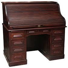 1910s petite antique wooden serpentine roll top desk with nine drawers at 1stdibs