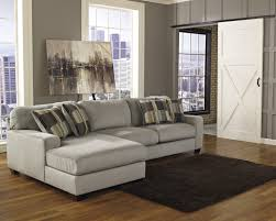 l shaped grey velvet sectional sofa and patterned cushions added by rectangle dark