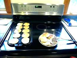 kitchen cabinets kitchenaid dishwasher parts countertops best cookware for electric glass top stove pans
