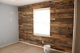 pallet wood garage wall. we have only walled up where the garage door and service had been so still a lot of work to do. pallet wood wall