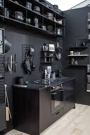 a black kitchen isn t the dark and gloomy space you might imagine in fact it s pretty bright and open is furnished right