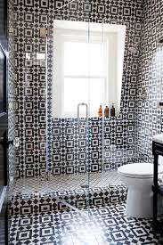 an alcove shower would llok great with interestisting graphic black and white patterned tiles