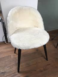 white furry chair faux fur