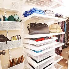 white elfa décor closet with utility door wall rack