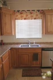 beautiful gorgeous kitchen window curtain ideas with beige stripes color cafe curtain over kitchen sink lining with hanging white shaker kitchen cabinet