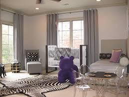 View in gallery Shades of beige and purple in a modern nursery