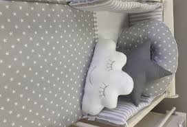 a soft grey background with fluffy white clouds this design can be beautifully coordinated with spots stars and narrow stripes creating a gorgeous theme