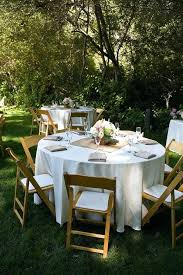 round table centerpieces round table with white tablecloth and a square brown gold runner table centerpieces