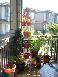 garden landscaping, Astonishing Frame Of Pot Which Is Made Of Metal  Enhancing Small Balcony Garden
