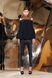 Selena Gomez wears a slinky black dress at Jingle Ball concert in.