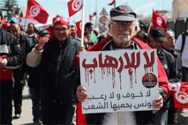 "the tunisia conundrum sowing dictatorship harvesting terrorism  a tunisian protester in 2015 carrying a poster speaks that says no fear and no terror and reaffirms ""tunisia will be protected by its people"""