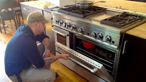 oven igniter replacement cost.  Igniter Appliance Repairman Looking Into An Oven Intended Oven Igniter Replacement Cost