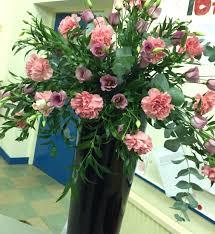FLOWER ARRANGEMENT: Grease FLOWERS: Laurel, Eucalyptus, Carnations ,  Lisianthus THEME: Songs