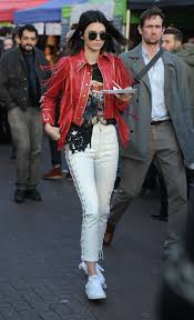 kendall jenner explores portabello market in london wearing a red leather jacket and white lace