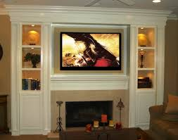 tv entertainment center with fireplace